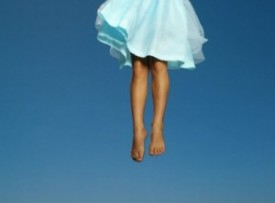 girl leaping into the air
