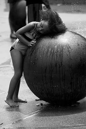 girl resting on a giant circle