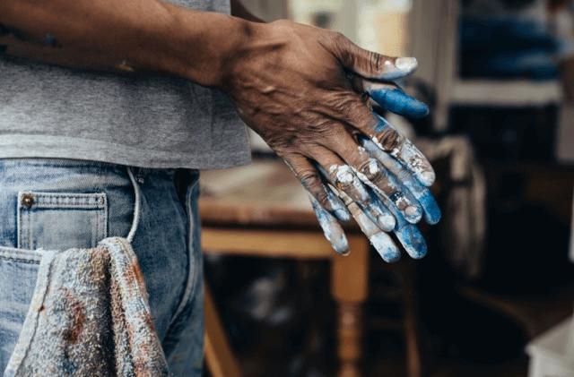 hand holding a firecracker